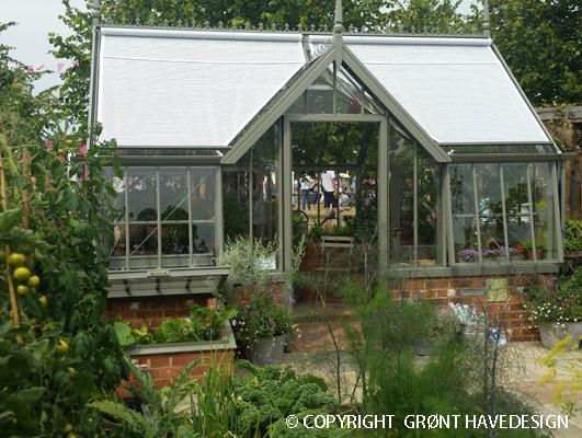 Nyttehave med drivhus
